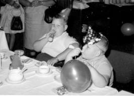 "My brother and I (on the left) at a kids' party in held in 1963 on board Hanseatic (1930).  See what fun we're having? ""Tooot, toooooot. Please throw me overboard."""