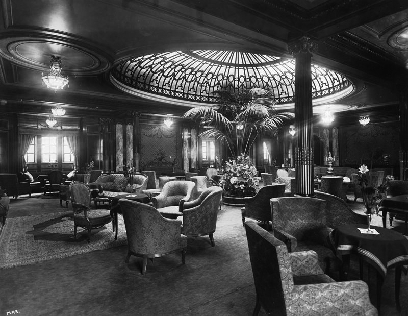 Mauretania's First Class lounge, including skylight and potted palm.