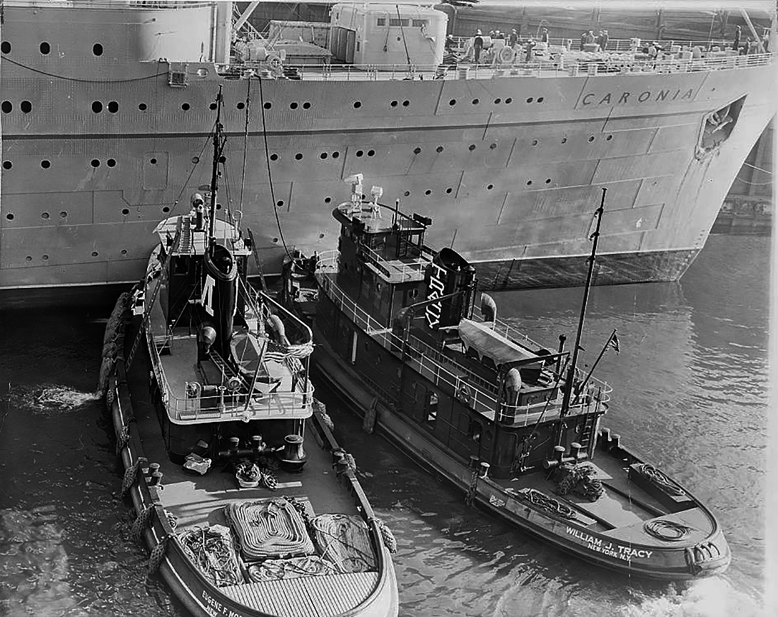 Tugboats assist Cunard Line's Caronia (1947).