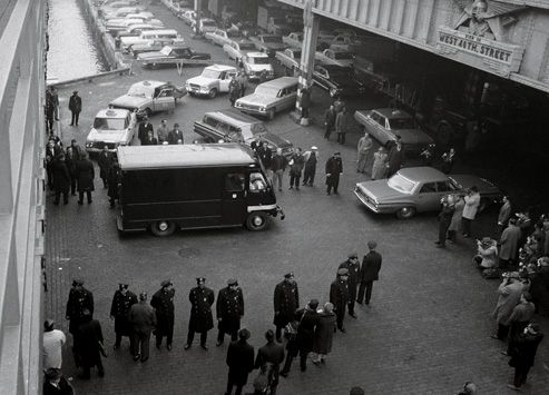 An armored car greeted Mona Lisa at the French Line pier in New York.