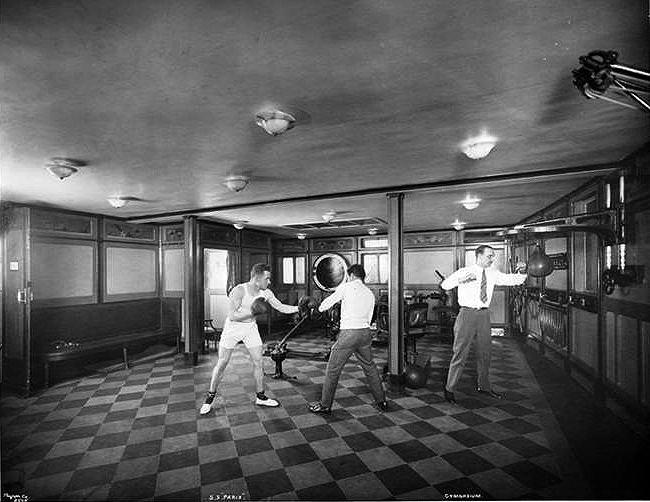 Gymnasium with boxers.