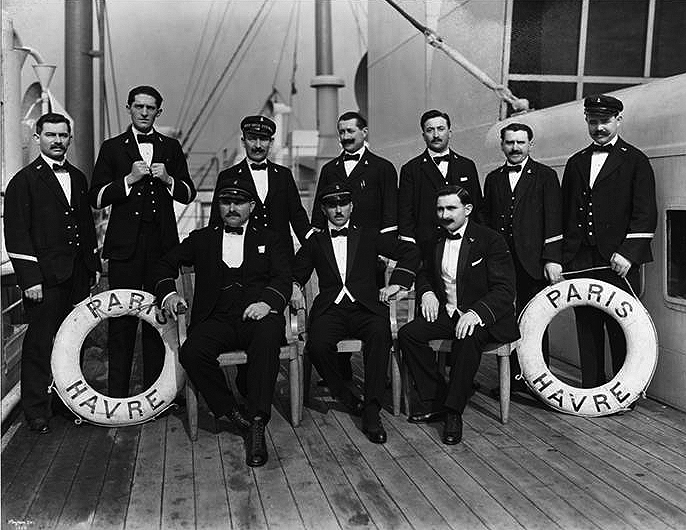 Head stewards pose on deck.